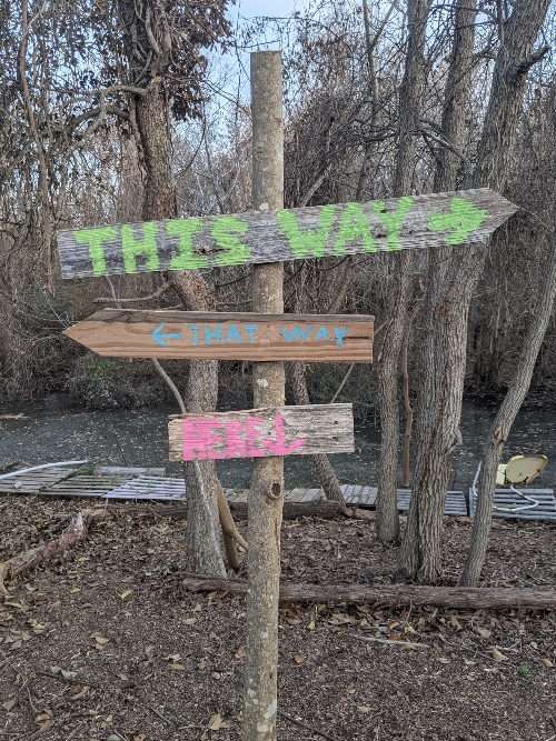The signs at the creekside playscape.